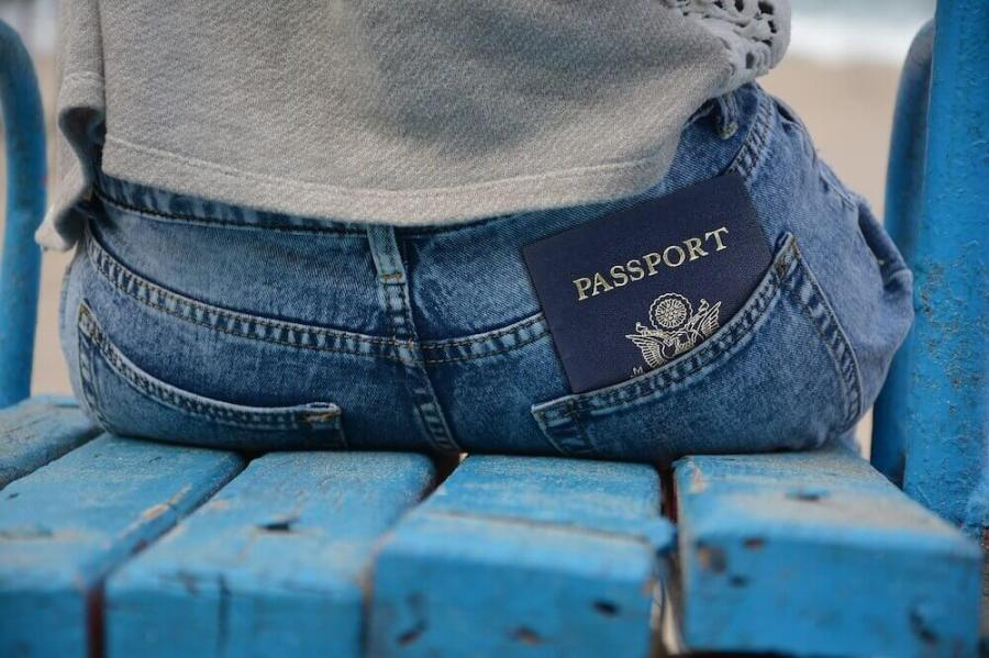 passport in the back pocket of jeans