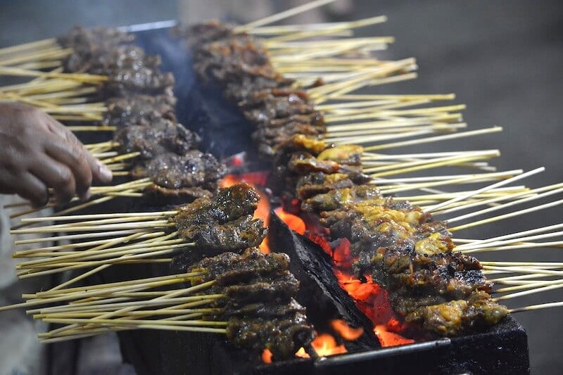Satay cooking over flame