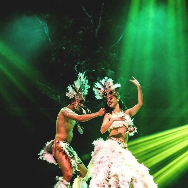 Tribal couple dancing. Rainforest Music Festival
