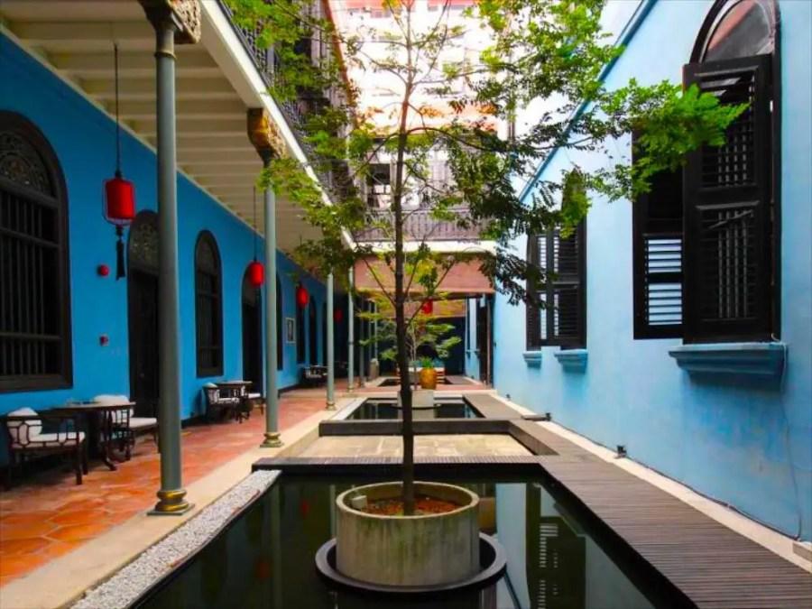 blue mansion room courtyard