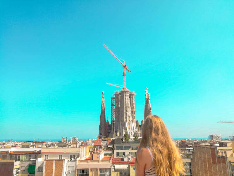 Vicky, a girl with long blonde hair looking over the Barcelona skyline.