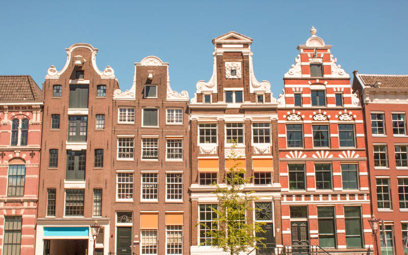 beautiful buildings in Amsterdam: reasons to move to another country