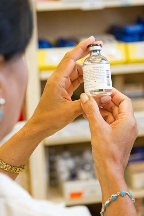 pharmacist looking at bottle