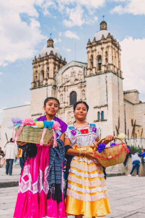 2 girls in colorful dresses in Mexico: Easiest countries for Americans to move