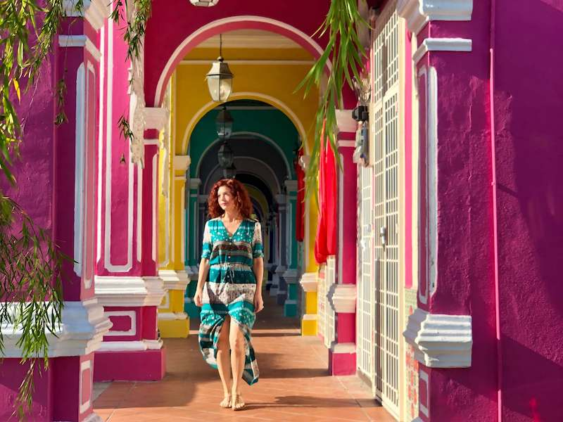 me in penang with colorful arches-best places to live in Malaysia