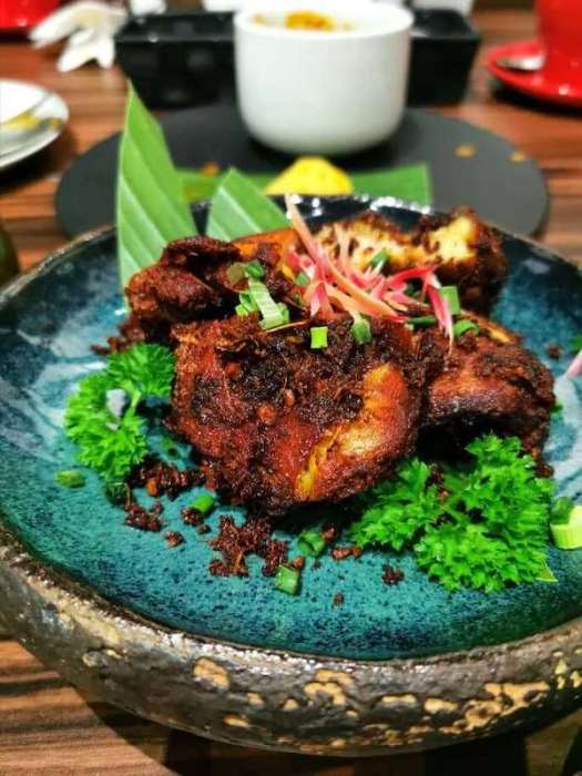 Fried chicken on blue dish