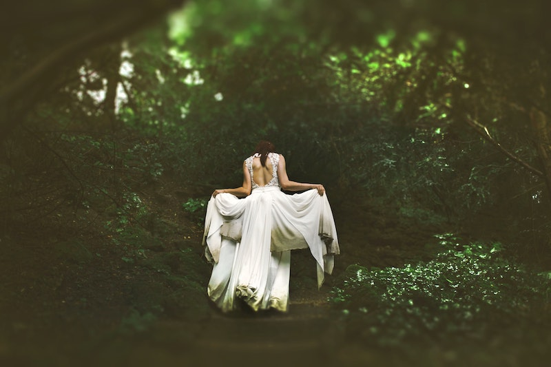 woman in forest white dress