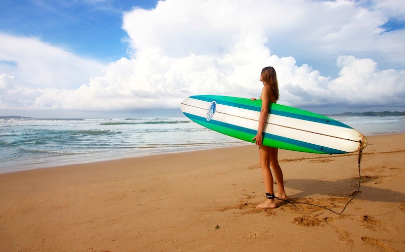 girl holding surf board in Cherating malaysia