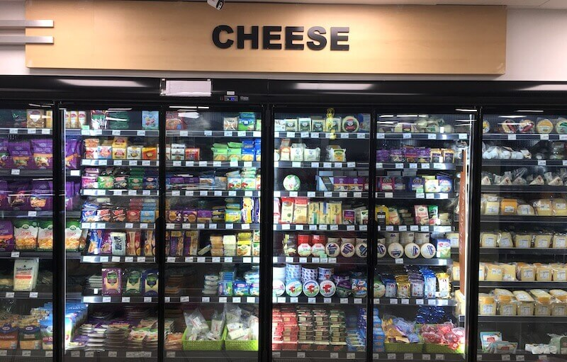 large cheese selection at a supermarket