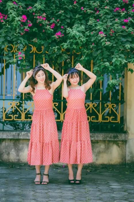 Malaysian women wearing matching red polka dot dresses