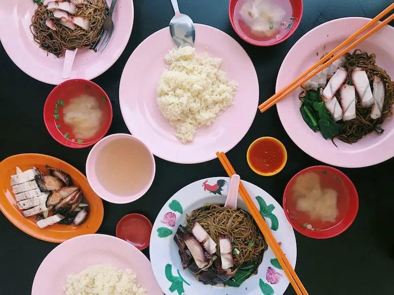 Malaysian food on pink plates