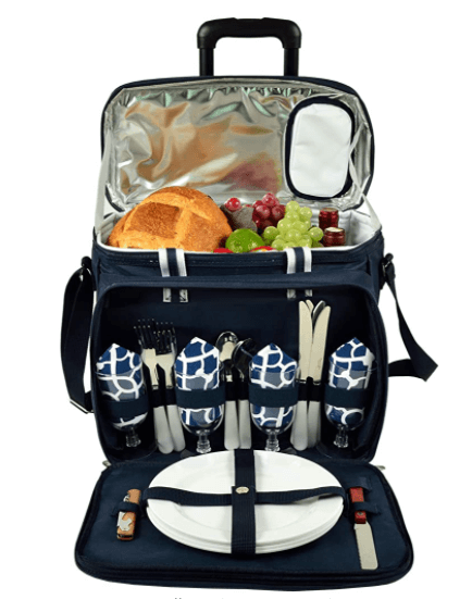 An open picnic basket full of food, plates, cutlery