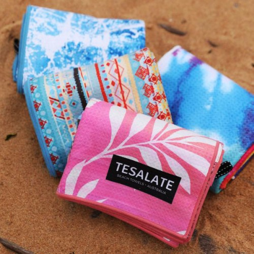 colorful folded towels make perfect gifts for the beach lover
