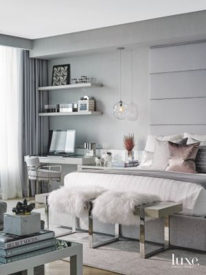 Gray Master Bedroom With Rose Gold Accent Pillow And Plush