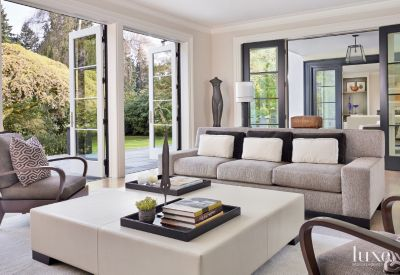 Contemporary White Living Room With Large Square Ottoman