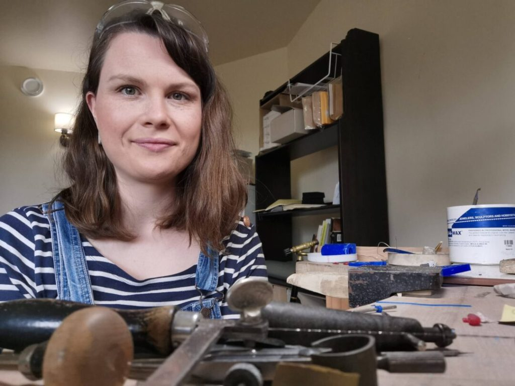 Sandra Hartwieg in workshop surrounded by jewellery tools