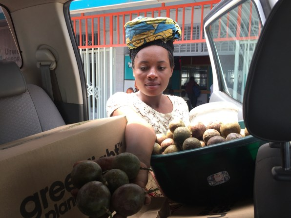 Buying passion fruit whilst parked