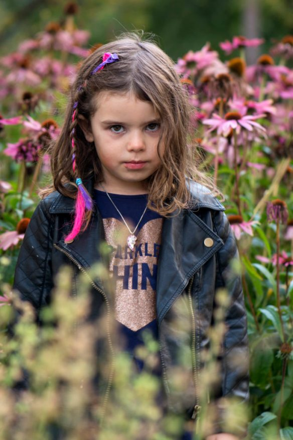 Young girl looking intensely into the camera.