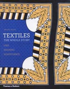Front cover of Beverly Gordon, Textiles, The Whole Story: Uses, Meanings, Significance (New York: Thames & Hudson, 2014 paperback). Detail of printed Kanga cloth, Tanzania, 2002. Collection of the British Museum.