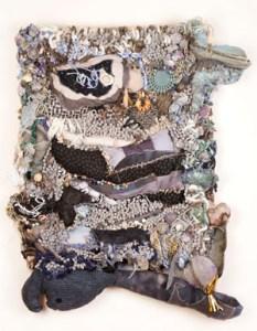 Harriet Cherry Cheney, Gray Areas, 2016, 29 x 24 x 4.5 in.; bath mat, fabric, beads, handmade paper and paper beads, wood, yarn, metal hooks, wood, Danish coaster.