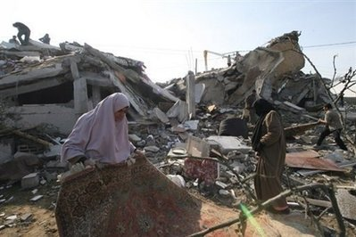 Palestinians sift though the rubble of destroyed buildings following Israeli air strikes in Rafah, southern Gaza Strip. (AFP/Said Khatib)