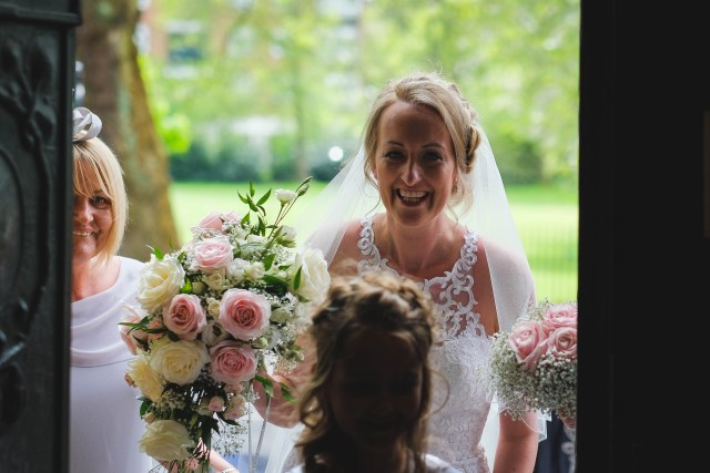 Documentary wedding photographer - bride arriving at Liverpool church