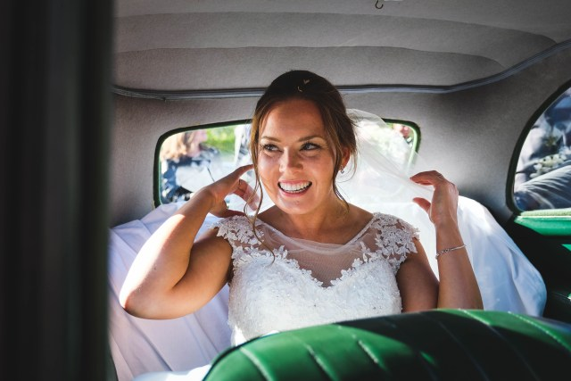 Bride in car on sunny day