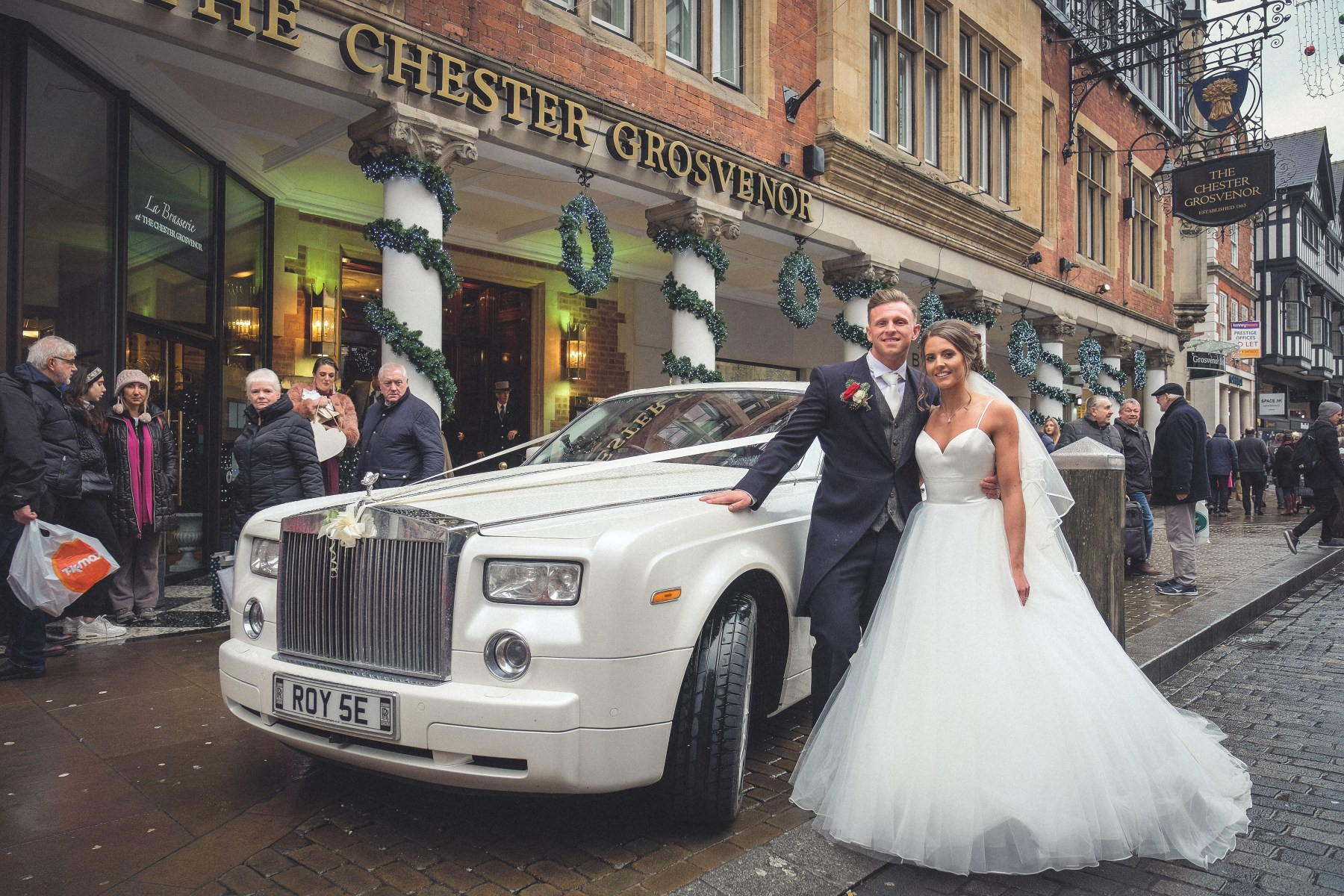 Bride and groom with wedding car at Chester Grosvenor Hotel