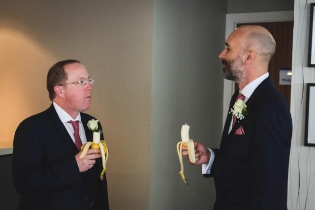 Groom and best man eating bananas at Holiday Inn Express Hoylake
