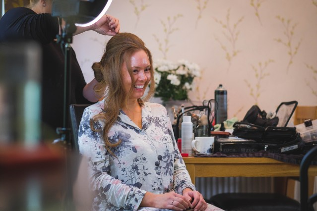 Bride getting ready at home in Wirral