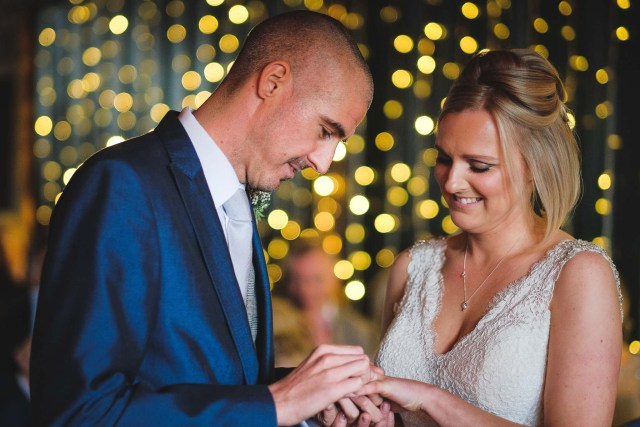 Exchanging rings during a Cheshire marriage ceremony