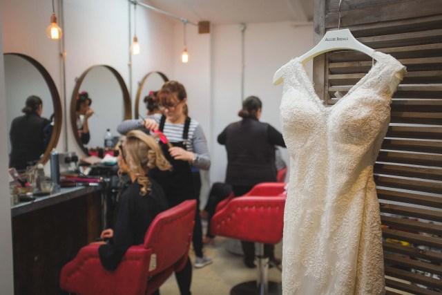 Photo of wedding dress hanging during bride prep