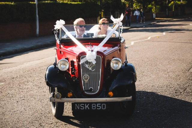 Bride arrives in vintage Austin 7 wedding car