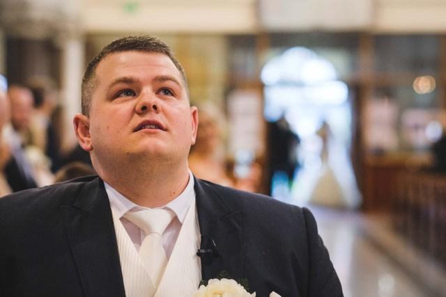 Nervous groom as his bride walks down the aisle
