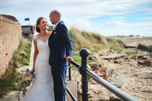 Bride and groom at Red Rocks on the Wirral for wedding photography