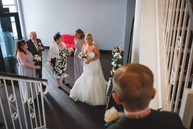 Bride looking towards her son, a pageboy.