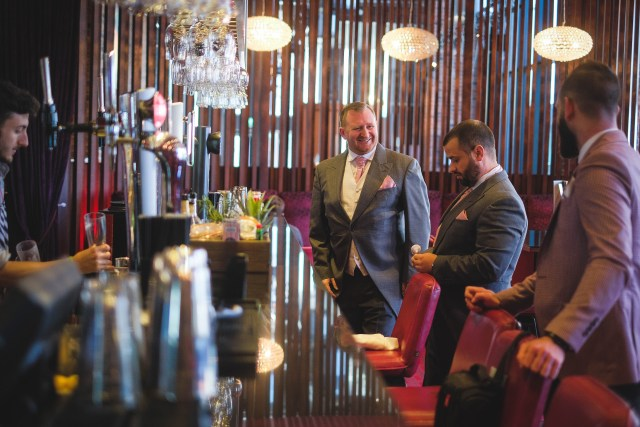 Groom in Liverpool hotel bar before the wedding