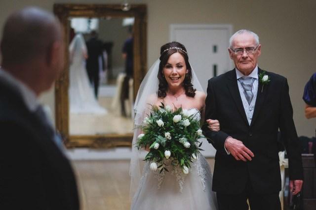 Wedding photographers - Bride walking down the aisle
