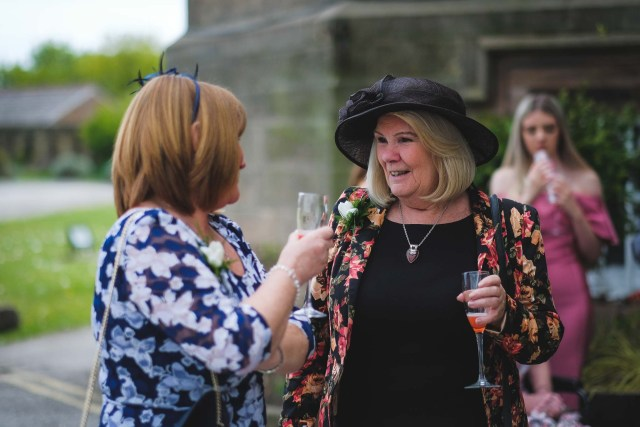 Documentary wedding photography Wirral - guests relaxing with a drink