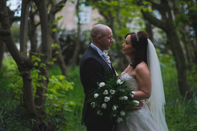 Bride and groom n the woodland at Leasowe Castle on the Wirral