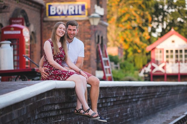 Couple in front of an old fashioned Bovril advertisement