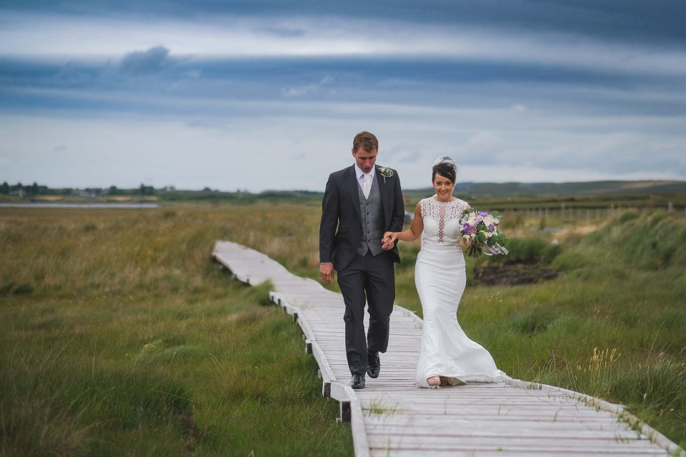 Bride and groom walking during photography session at Irish destination wedding