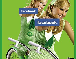 twins riding a bike holding up facebook banners