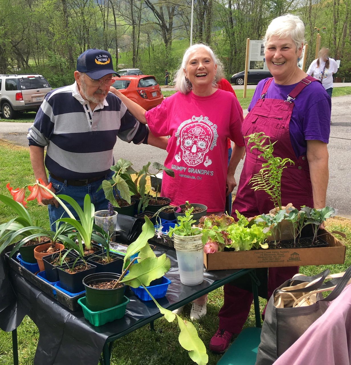 friends at Garden Swap table with plants
