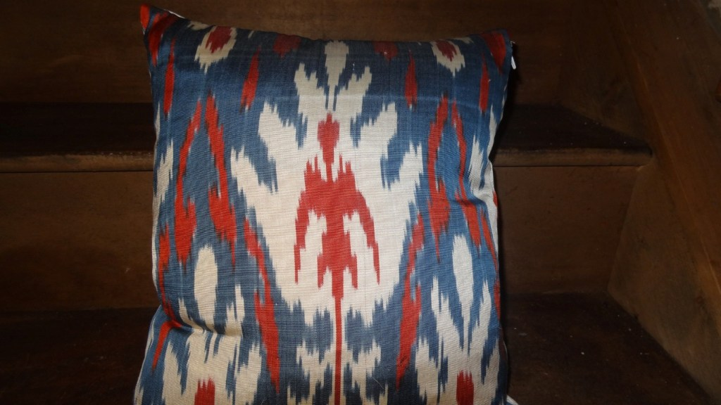 Feather filled ikat cushion