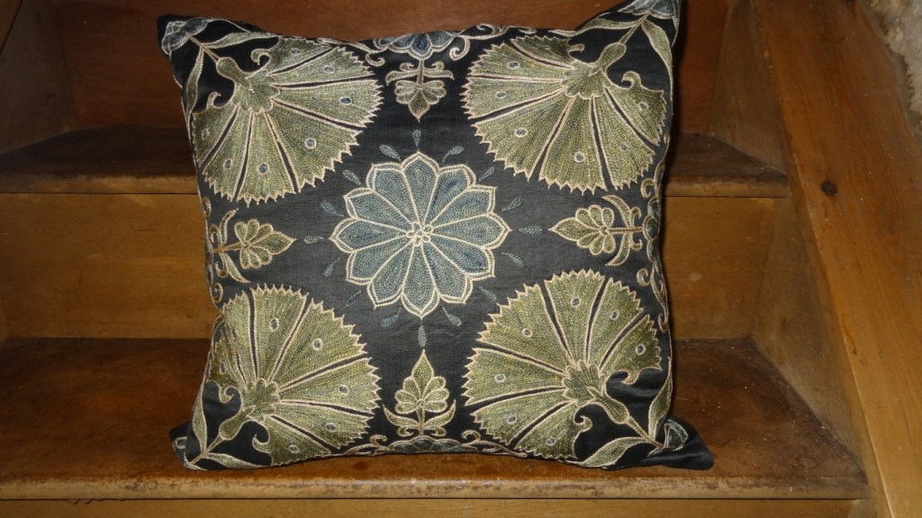 Hand stitched susani cushion from central Asia