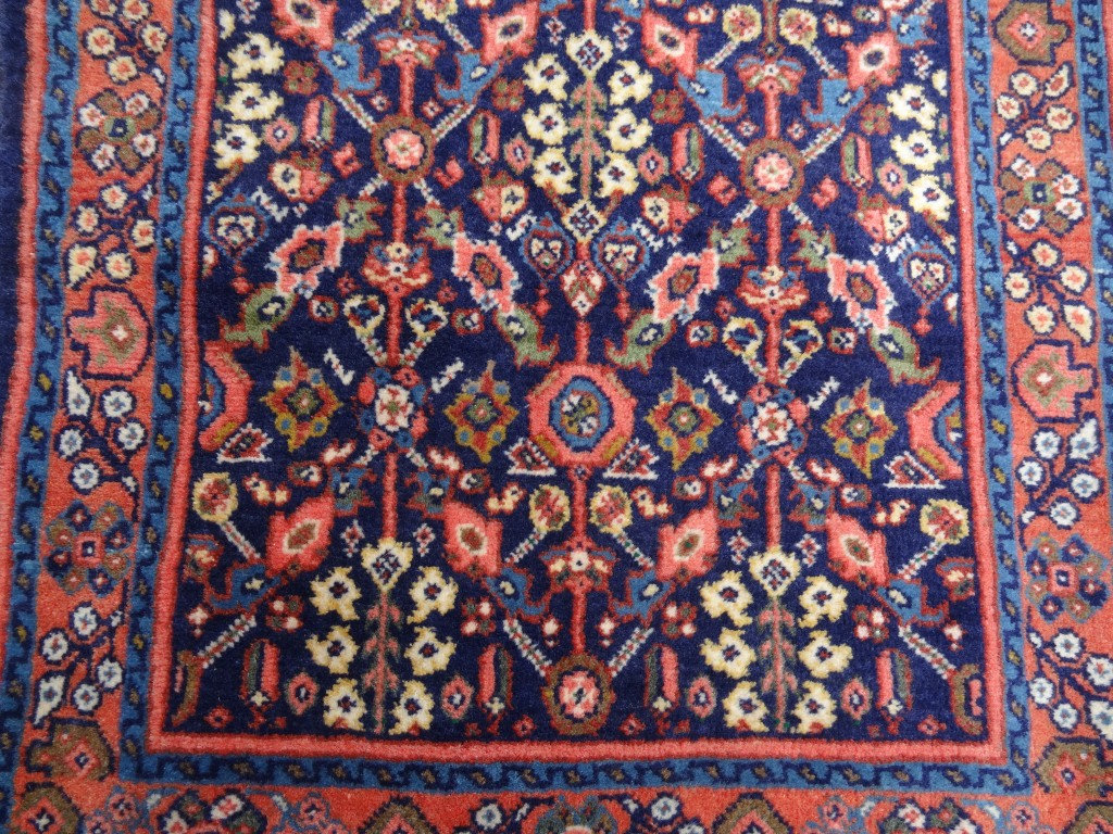 Small semi antique dark blue and pink rug from Persia