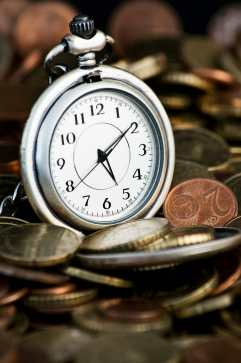 Time is money concept with clock and coins insurance