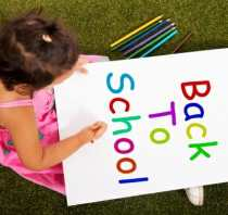 back to school organization/child with colored pencils and paper/sanespaces.com