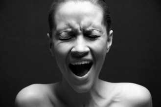 black and white photo of woman screaming